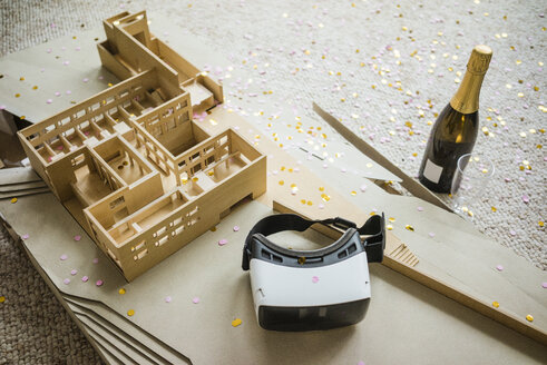 Still life with architectural model, confetti, bottle of champagne and VR glasses - JOSF01969