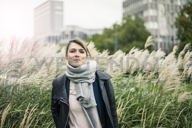 Portrait of smiling woman with scarf outdoors - JOSF02005