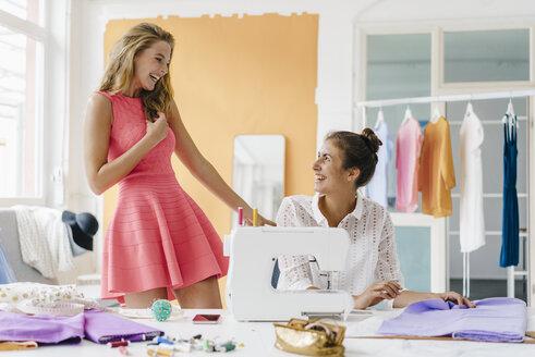 Two happy young women in fashion studio - KNSF02961