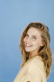 Portrait of happy young woman - KNSF03033