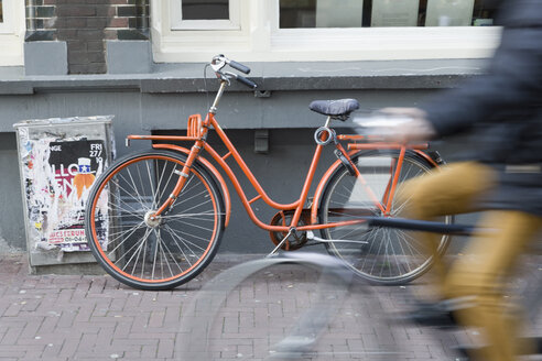 Holland, Amsterdam, cyclist, parked cycle - KLRF00554