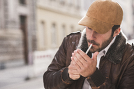 Man lighting cigarette - UUF12322