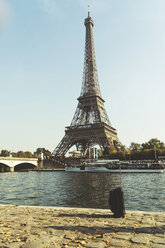 France, Ile-de-France, Paris, Eiffel Tower, Seine river and trolley in foreground - CHPF00451