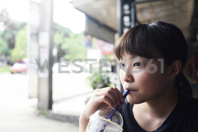 Portrait of pensive woman drinking smoothie - IGGF00221