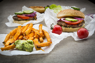 Homemade burger with sweet potato fries and avocado dip - LVF06438