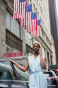 USA, New York, young blonde african-american woman using smartphone - MAUF01253