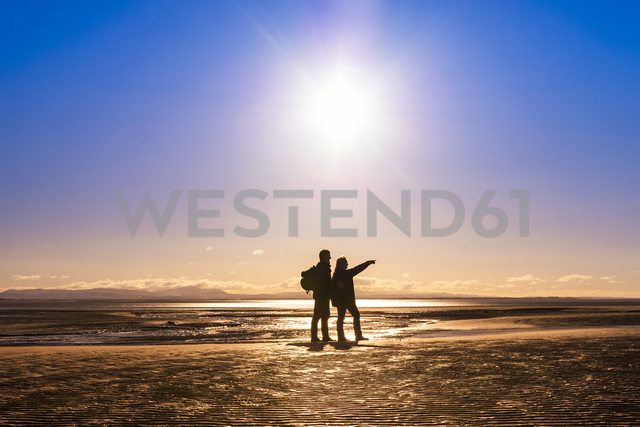 Great Britain, Scotland, Solway Firth, silhouette of mature couple - SMAF00876 - Scott Masterton/Westend61