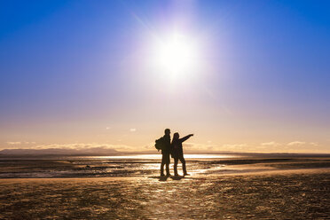 Great Britain, Scotland, Solway Firth, silhouette of mature couple - SMAF00876