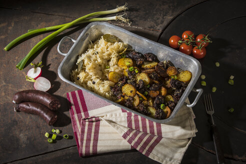 Blunzngroestl, fried blood sausage with fried potatoes and sauerkraut - MAEF12462