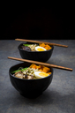 Ramen with noodles, egg, hokkaido pumpkin, mung sprout, shitake mushroom in bowl, chopsticks - LVF06454