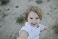 Portrait of happy little girl - KMKF00064
