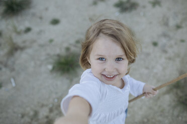 Portrait of happy little girl - KMKF00064