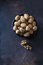 Bowl of walnuts on dark metal - CSF28573