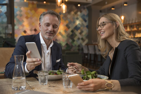 Two business people having lunch in a restaurant - SUF00351