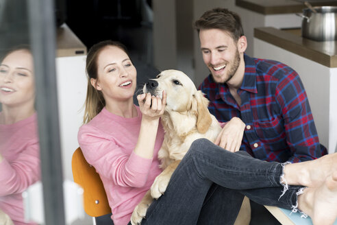 Happy young couple with dog at home - PESF00822