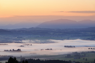 Germany, Bavaria, Upper Bavaria, Allgaeu, Pfaffenwinkel, View from Auerberg near Bernbeuren, morning fog over Lech Valley during sunrise - SIEF07637