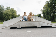 Two young women talking in a skatepark - KNSF03051