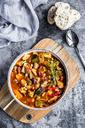 Vegetable chili with kidney bean, sweet potatoe, champignon, corn, snow pea, baguette in bowl - SARF03440
