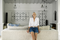Portrait of beautiful senior woman in her living room - SBOF00936