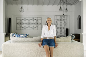 Portrait of beautiful senior woman in her living room - SBOF00936