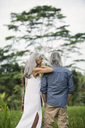 Senior couple looking at tropical landscape - SBOF00972