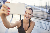 Fit woman taking selfie after outdoor workout - BSZF00116