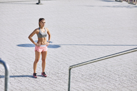 Portrait of young woman getting ready for outdoors workout - BSZF00128