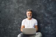 Mature man using laptop - HAPF02451