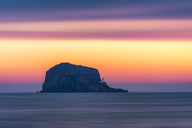 Great Britain, Scotland, East Lothian, North Berwick, Firth of Forth, view of Bass Rock at sunrise, lighthouse - SMAF00894