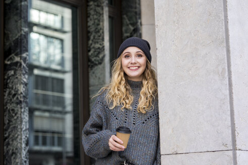 Portrait of fashionable young woman with coffee to go in autumn - FMKF04670