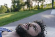 Relaxed man lying in skatepark - KNSF03177
