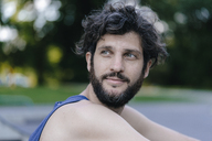 Portrait of smiling man with beard looking around - KNSF03180