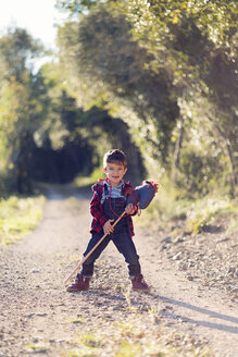 Boy with a hobby horse standing on way - XCF00163