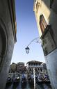 Italy, Veneto, Venice, alley and gondolas - FCF01320