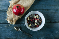 Bowl with dessert of almonds, pomegranate seed and dark chocolate - KIJF01793