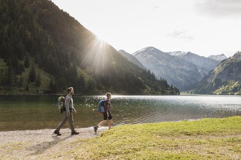 Austria, Tyrol, young couple hiking at mountain lake - UUF12467