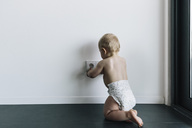 Baby touching unsecured power outlet - MFF04227