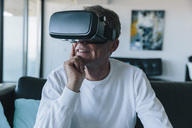Man wearing VR glasses in an apartment - MFF04245