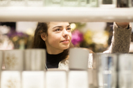 Portrait of young woman in a shop - SGF02128