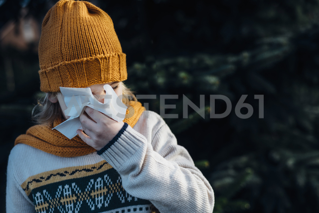Little boy having a cold, blowing his nose - MJF02218
