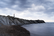 Spain, Balearic Islands, Menorca, Favaritx lighthouse surrounded by clouds in the morning - IGGF00268