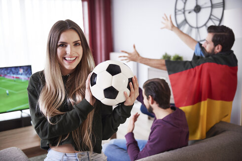 German football fans watching match on Tv together - ABIF00074