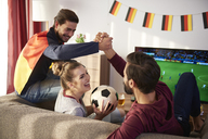 German football fans watching Tv and cheering - ABIF00083