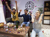 Excited fans celebrating at football party - ABIF00098