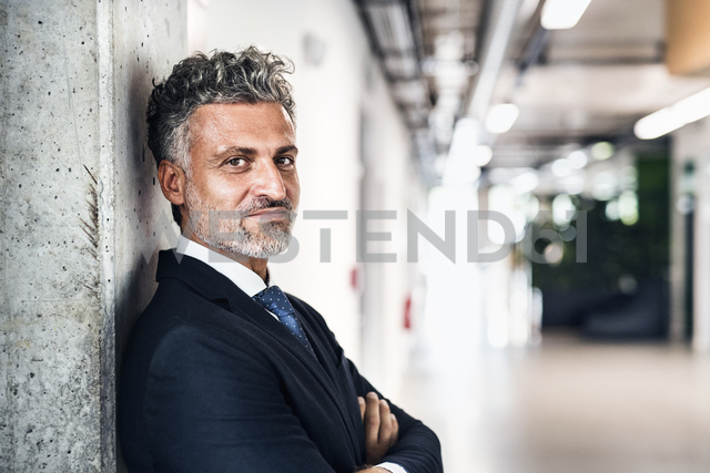 Portrait of confident mature businessman - HAPF02511
