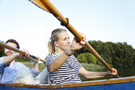 Young couple enjoying a trip in a canoe on a lake - FKF02830