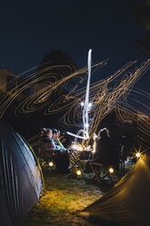 France, group of friends camping at night - GUSF00277