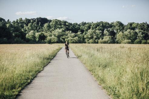 Young man riding a bike - GUSF00289