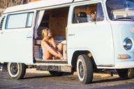 Spain, Tenerife, blonde woman sitting in an old van - SIPF01877
