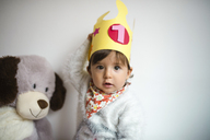 Portrait of baby girl with paper crown on first birthday - GEMF01826
